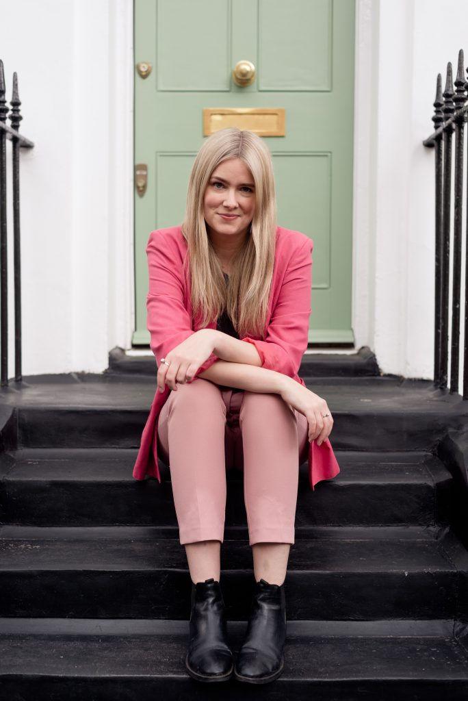 blonde lady sitting on steps in London personal branding session