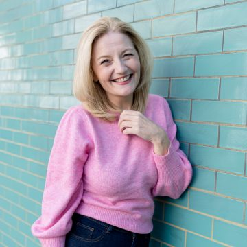 Wendy Bollard wearing pink jumper in Notting Hill personal brand photography London