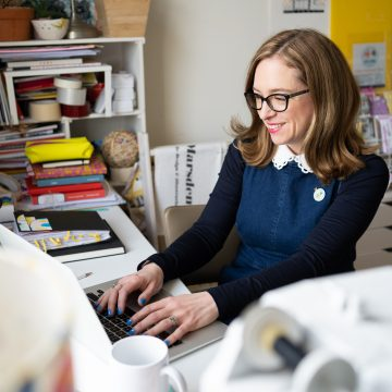 portrait of business owner working on her laptop