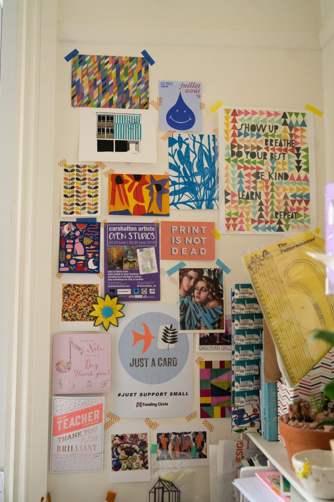collage wall of inspirational quotes and cards