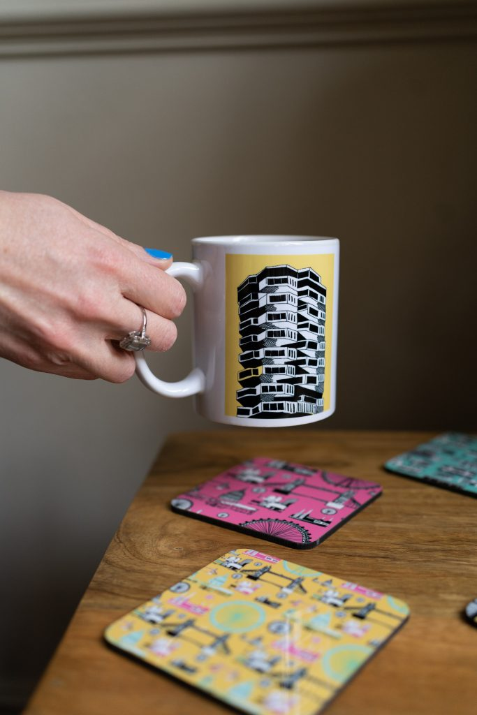 woman holding mug with print on with colourful placemats