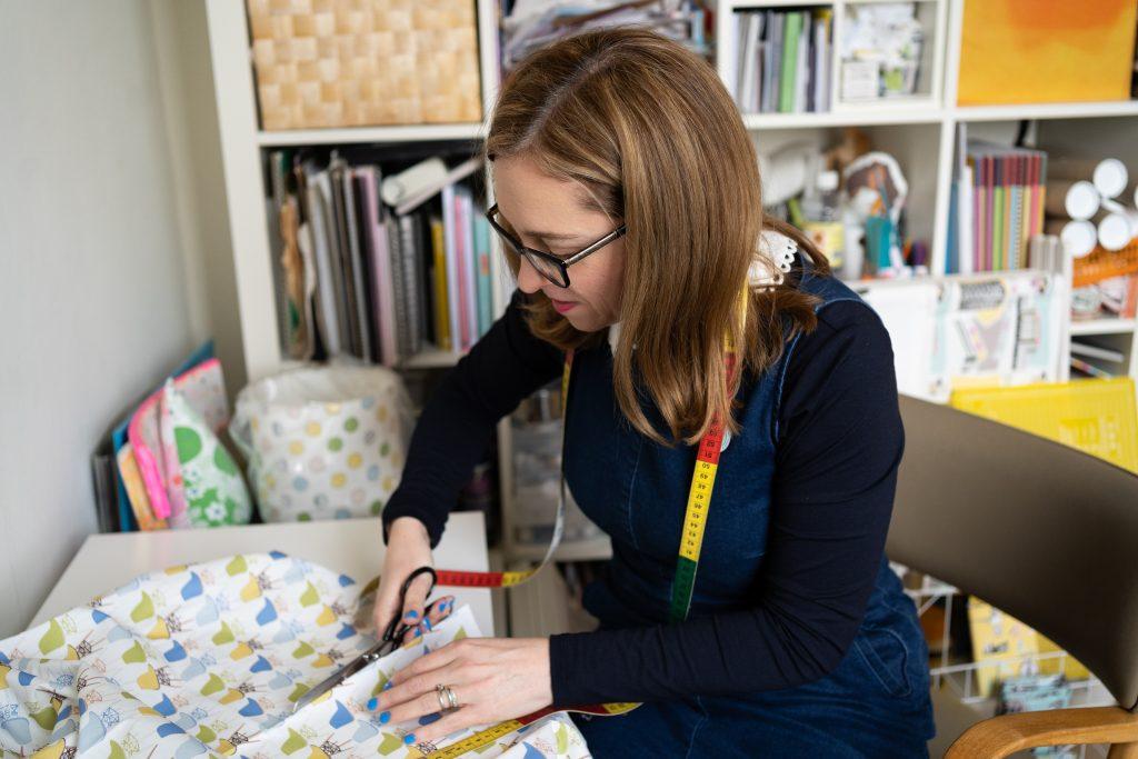 Kate Marsden textile designer at work cutting fabric