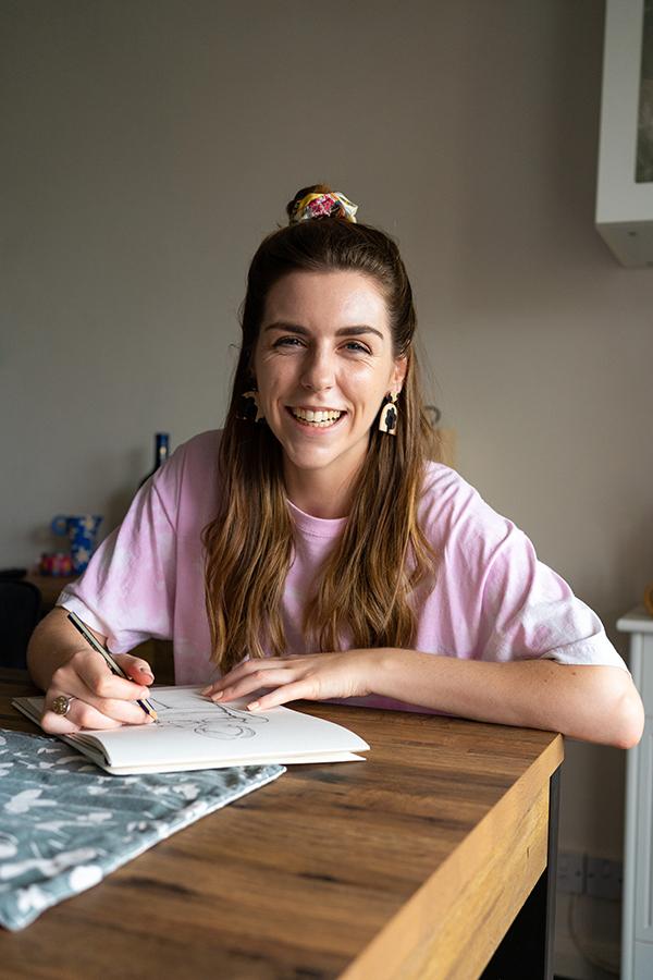 woman drawing illustrations at home studio