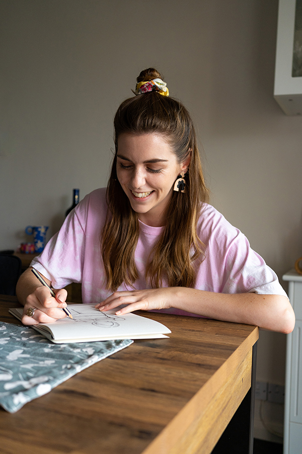 woman laughing at drawing home studio