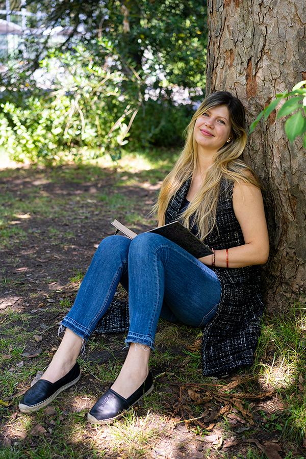 woman sitting by a tree in Battersea Park