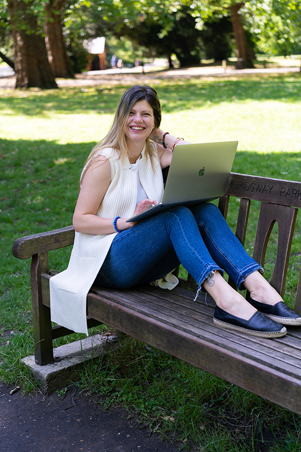 woman working on her laptop in Battersea Park