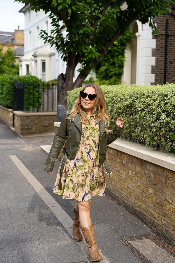 woman walking through Wimbledon with sunglasses