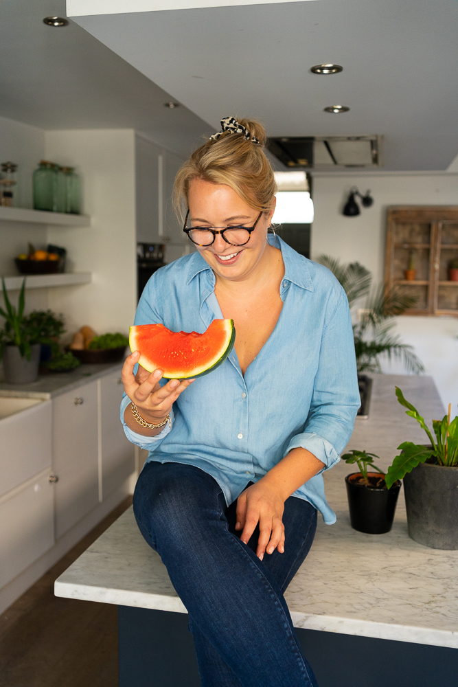 nutritional therapist eating a Watermelon