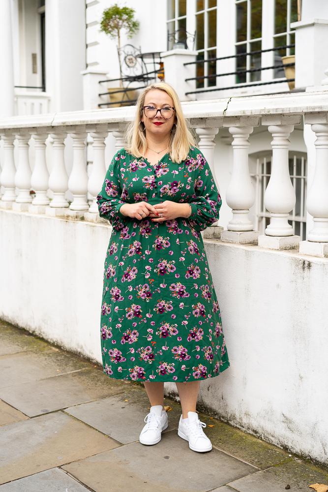 blonde female entrepreneur in green dress
