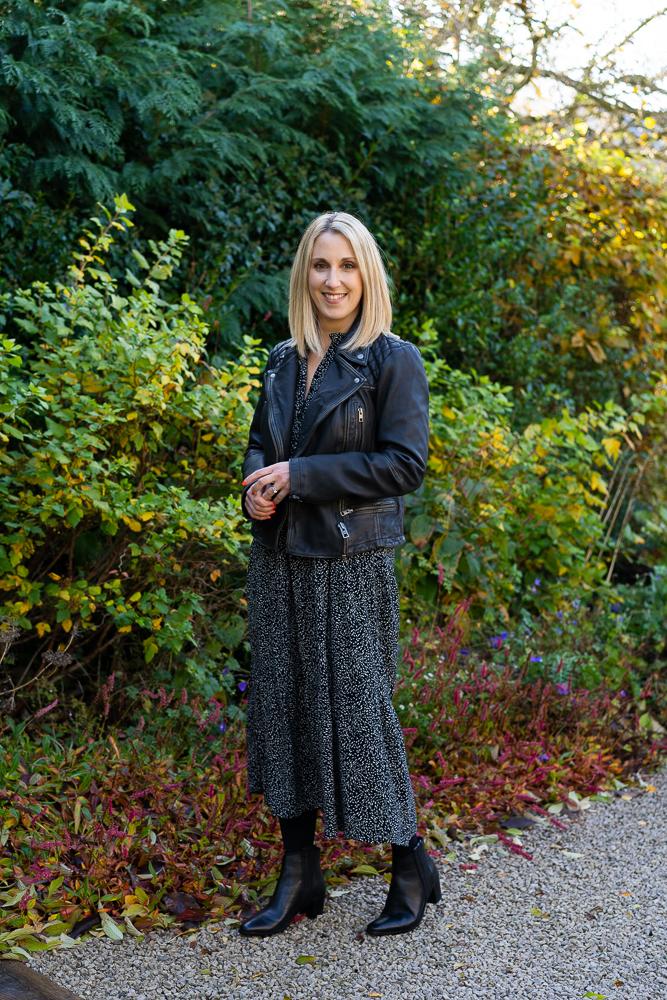 blonde woman walking outside in garden